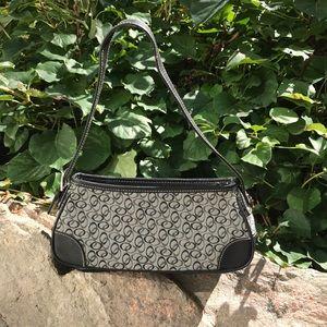 Grey and black handbag. Includes zipper and buckle